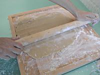 rolliing dough parallel to board